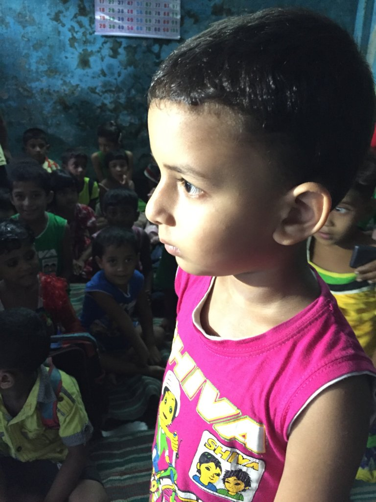 A child reciting poetry in a DoPeace school