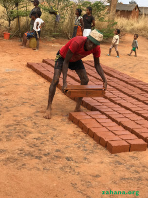 making the bricks for the 'rabbit house'