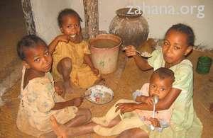 Children enjoying their breakfast of rice
