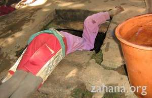 Boy gets water at Fiarenana's communal well