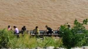 North Korean refugees crossing Mekong River