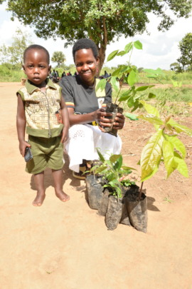 a mother and son receiving seedlings