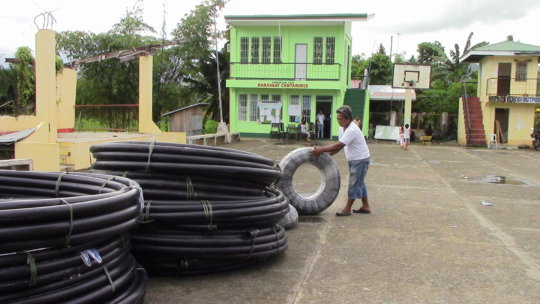 community member inspecting pipes