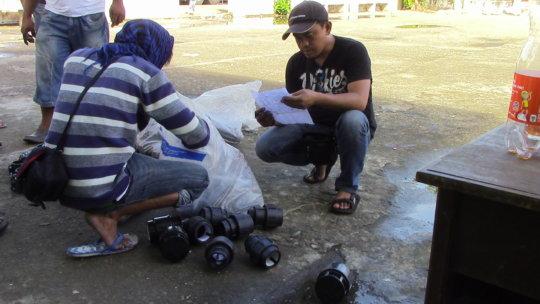 sibat technician inspecting pipe couplings