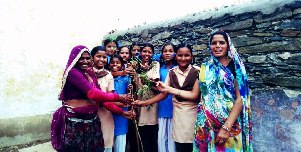 Girl Students are Planting Trees in school