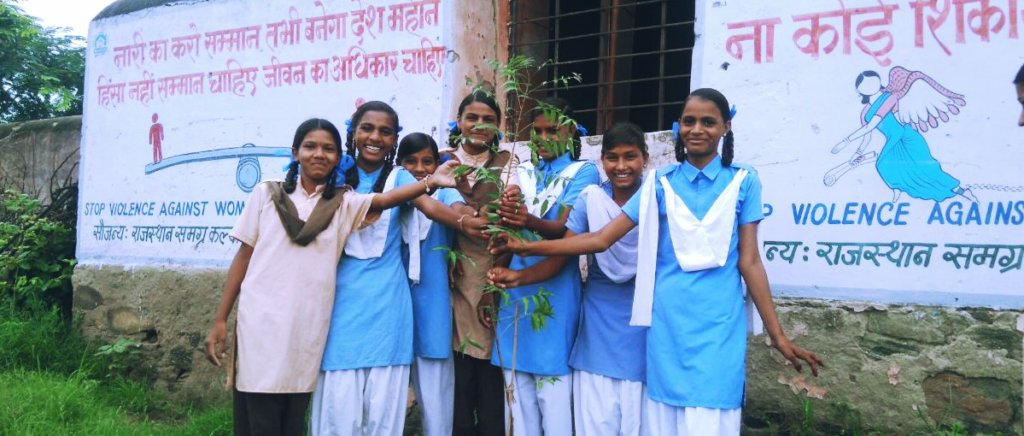 Girl Student are planting Trees