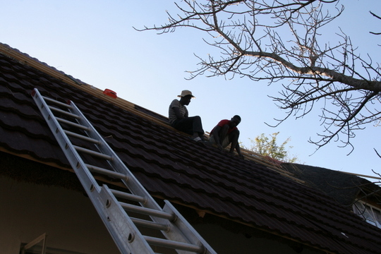 Working on the roof into the evening
