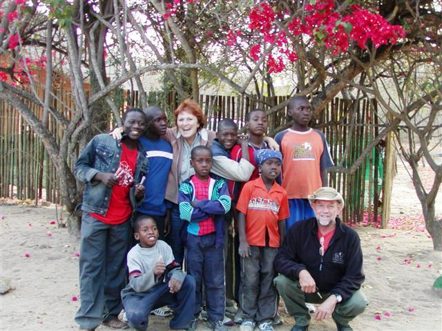 Ian and Michele with a group of Children at Daktari