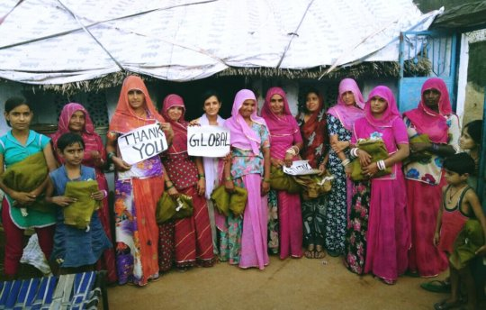 Beneficiary women giving thanks to GG