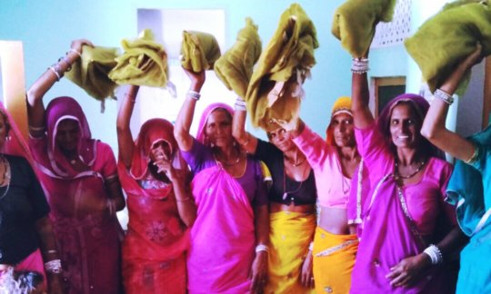 Happy Women with mosquito net