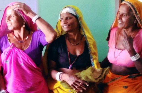 Happy Rural Women with mosquito net