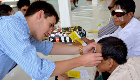 Volunteer Working with an Eye Patient