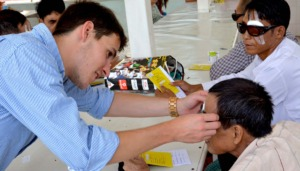 Volunteer Working with an Eye Patient