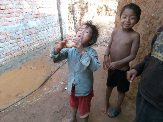 Young children drinking alcohol to keep them going