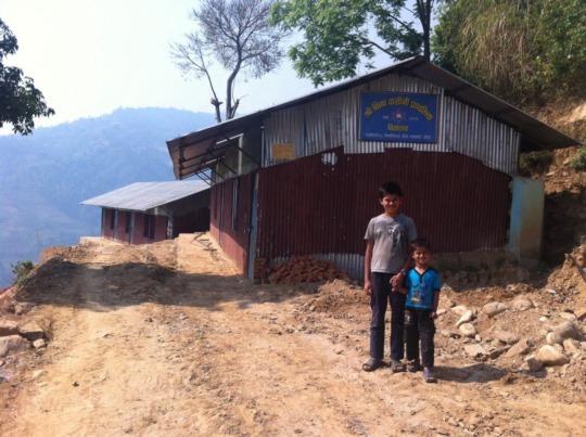 TLC Replaces School Building