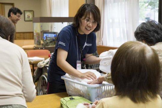 Yuka facilitating group discussion and activities