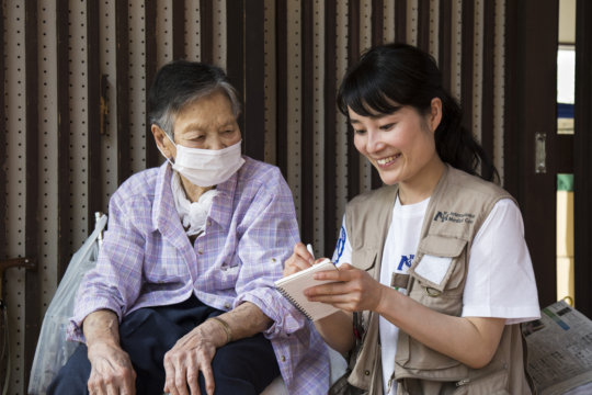 International Medical Corps staff helps a survivor