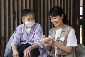International Medical Corps staff helps a survivor