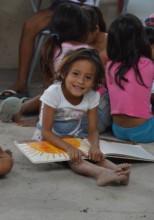 A child reading a book with Fundacion Clara Luna