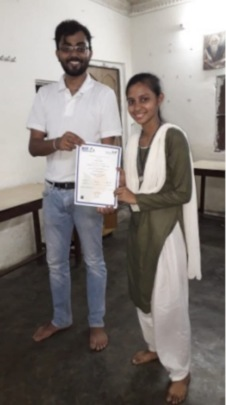 Ayesha receives basic computer course certificate