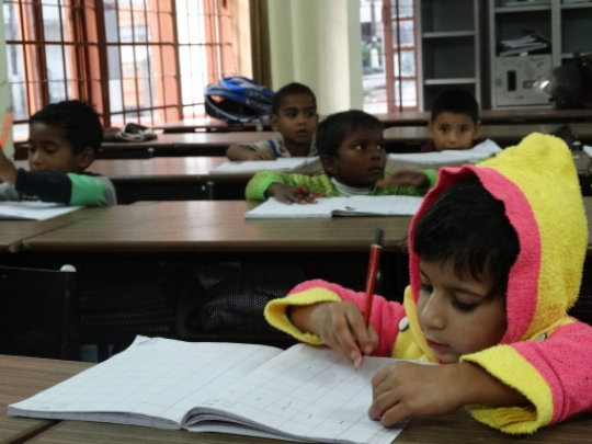 Children receive guidance with Homework
