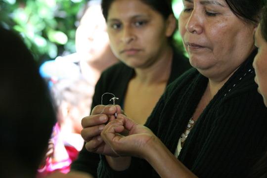 Women pass around copper IUD during talk