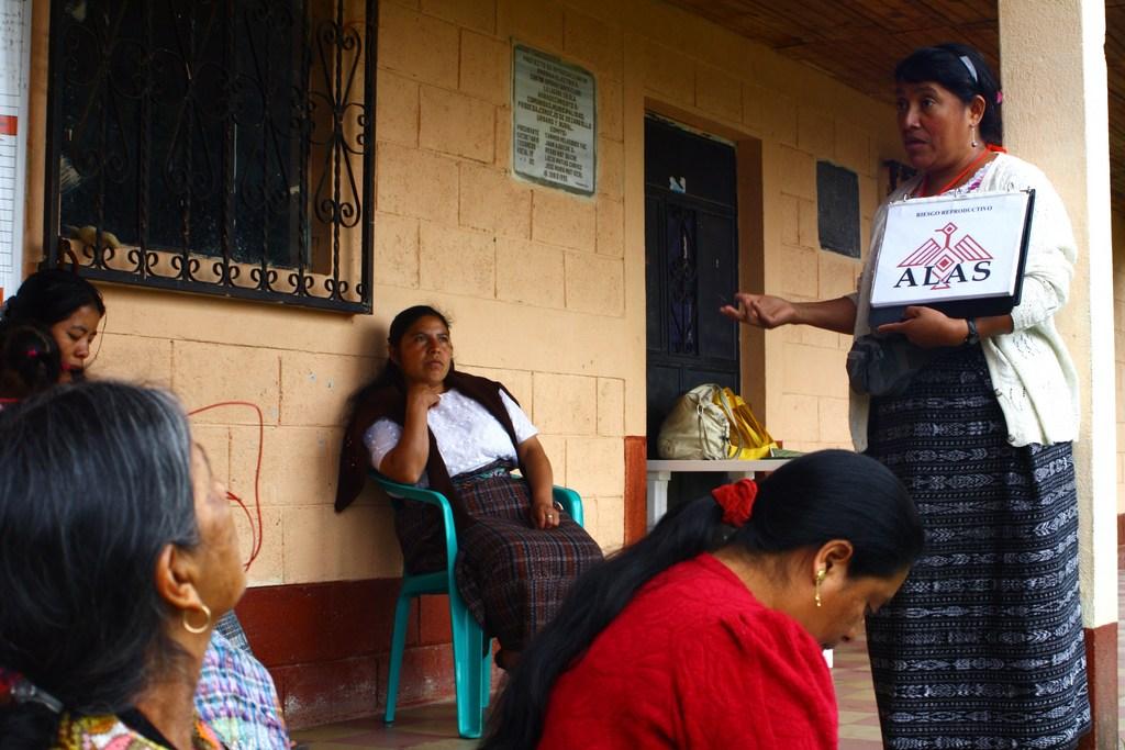 WINGS field educator talks to a group of women