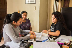 Tania, right, meets with promotoras regularly
