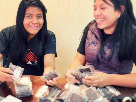 Our youngest team members preparing snacks