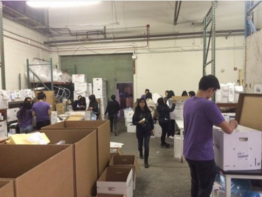 VIDA Volunteers sorting supplies at the warehouse