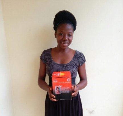 Aminata holding her new solar light