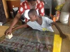 Children learn batik making