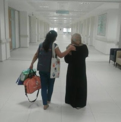 A. S. and her mother leaving the hospital.