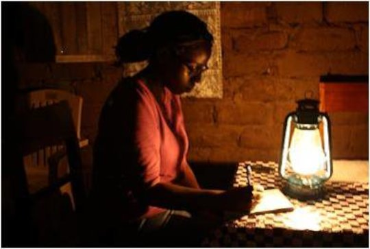 Sylvie writing blogs in the DRC, 2010