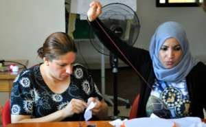 Sewing tiles for the refugee quilts in Jordan