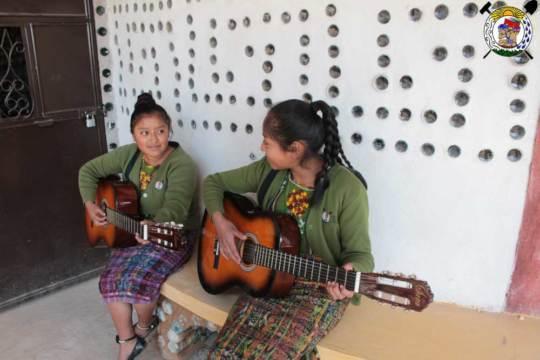 Students playing gitar