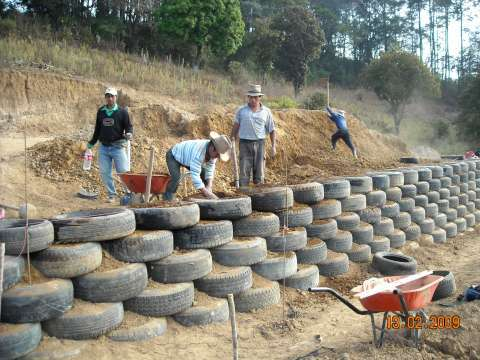 Retaining wall made out of old tires and plastic bottles