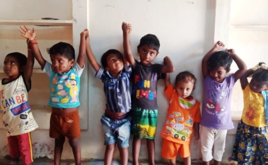 Krish playing with other children