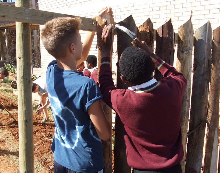 Buddies at work putting up the fence