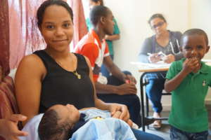 Mother and infant being treated at clinic.