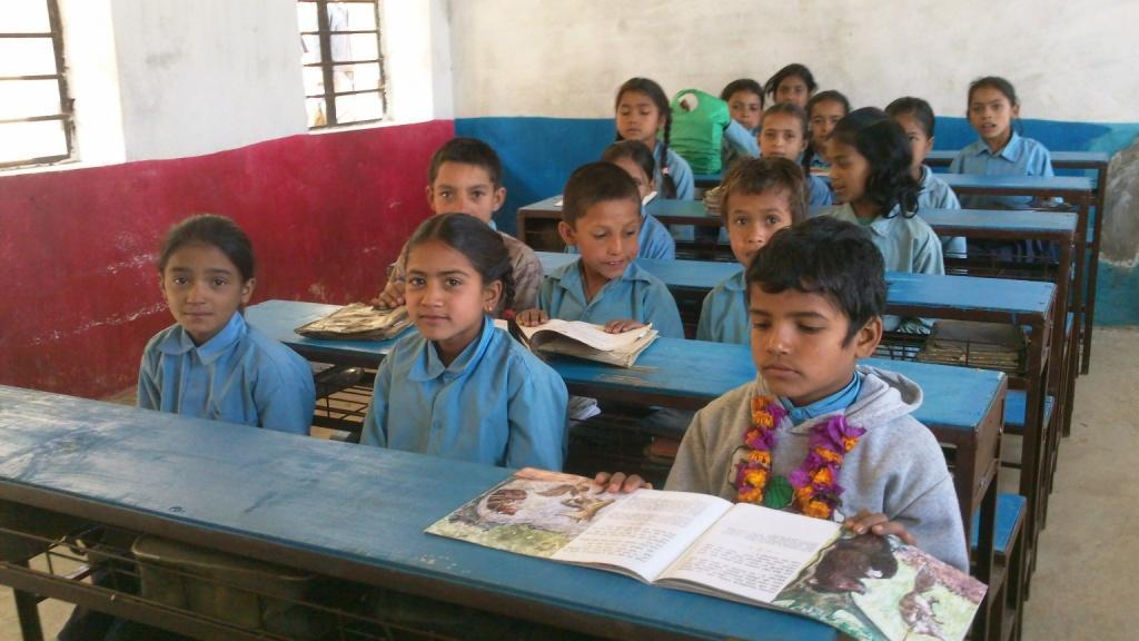 Students in Nepal share long desks and benches