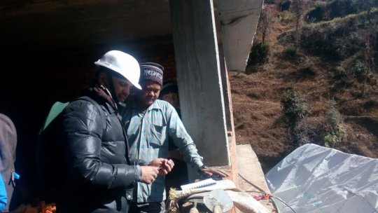 Engineers supervise reconstruction work.