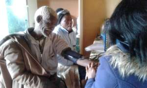 Clinic staff attend to an elder at Old Age Club