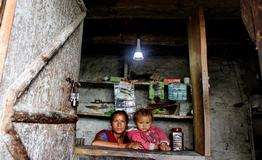 Local tea shop benefiting from solar lamps -and p
