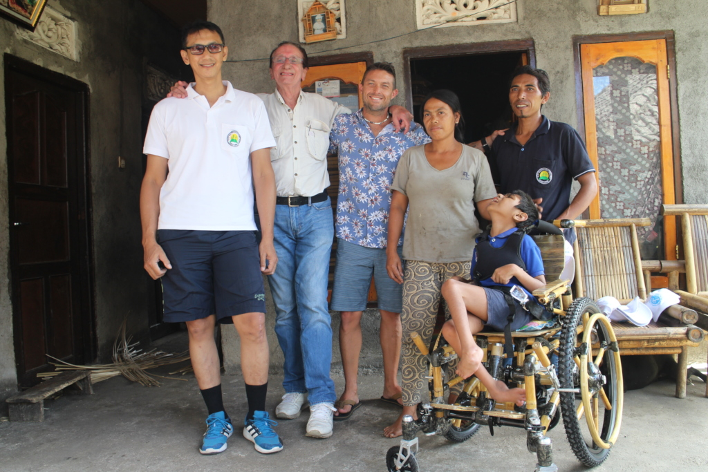 Deni, David, Brad & parents - wheelchair handover