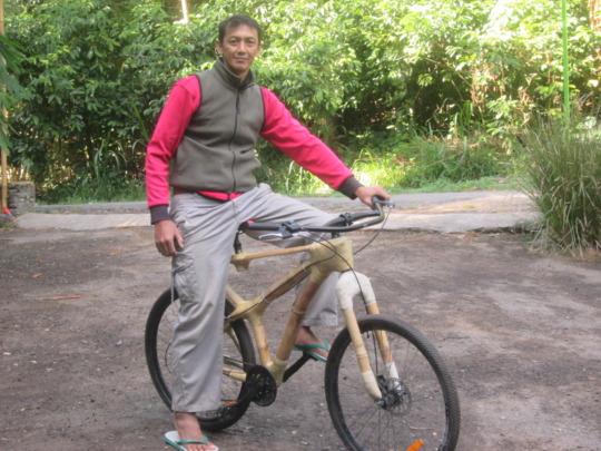 Deni proudly sits on new bamboo bike prototype