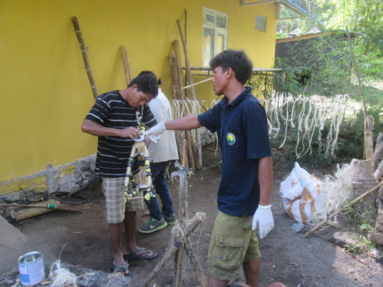 Early stages of bamboo bike frame, outside worksho