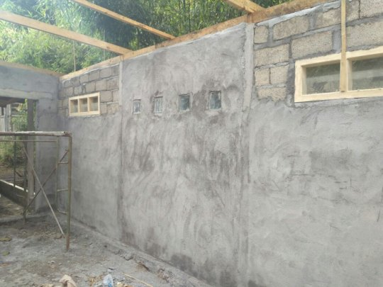 Windows in place and walls plastered