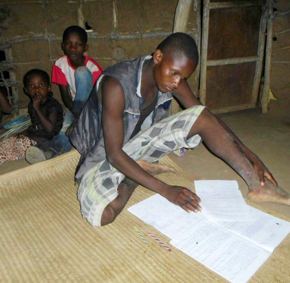 Ali completing his homework using solar lantern