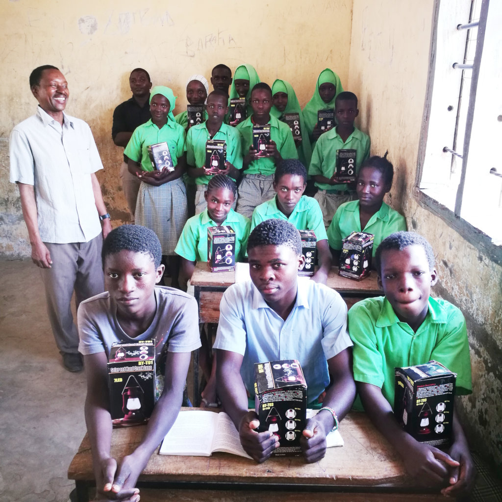 The Headteacher Mr. Emmanuel and Students